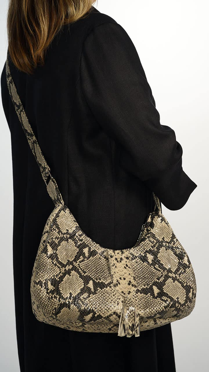 Genuine Leather Half Moon Bag with Swirl Quilt design in Python Print